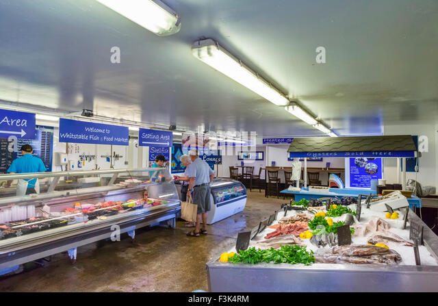 The Fish and Food Market by the harbour in Whitstable, Kent, England, UK - Stock Image