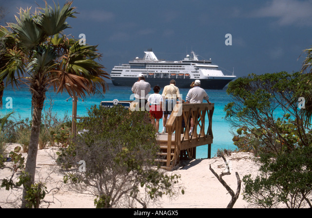 Bahamas Half Moon Cay Holland America Line ms Maasdam beach cruise ship passengers raised observation deck - Stock Image