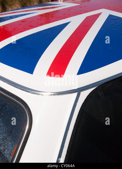 Close up of an historic 1993 white BMC Mini 1275 motor car with a Union Flag painted on its roof - Stock Image