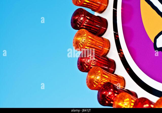fair carnival amusement park decent honourable red lighting illumination light - Stock Image