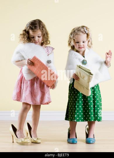 girls playing dress up - Stock Image