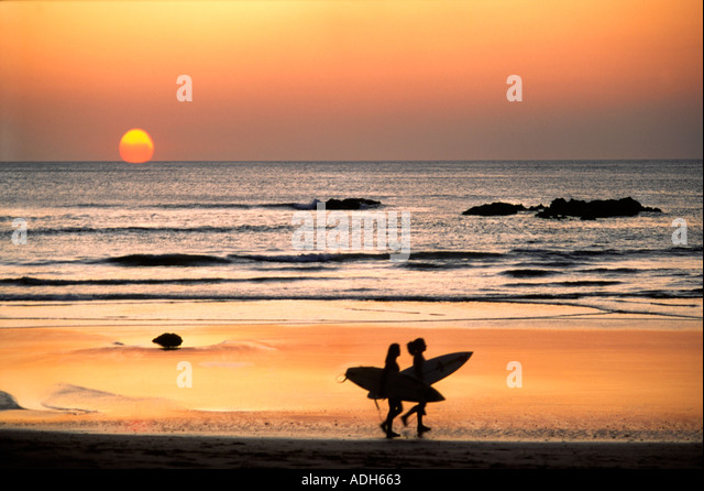 Costa Rica Playa de Coco Sunset Surfer  - Stock Image