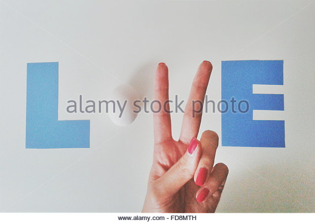 Egg And Female Hand Completing Love Text On Wall - Stock Image