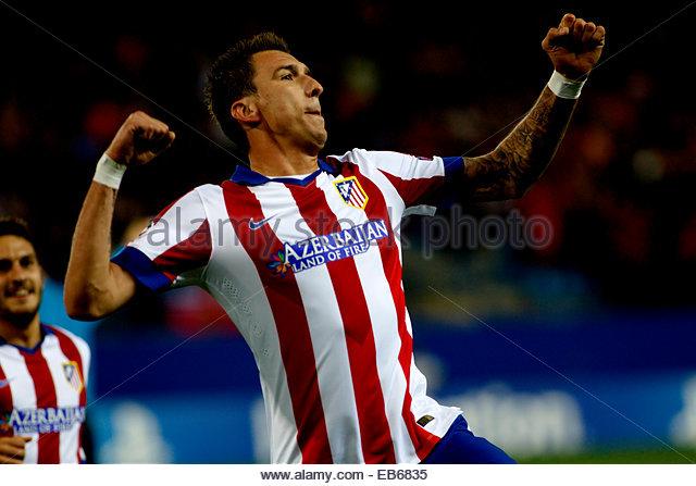 SPAIN, Madrid: Atletico de Madrid's Croatian forward Mario Mandzukic Celebrates a goal during the Champions - Stock Image