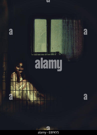 Scary child in cage - Stock-Bilder