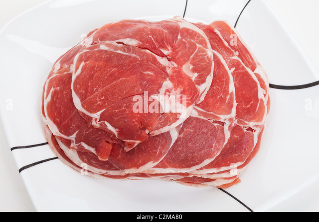 mutton slices cooked in hot pot - Stock Image