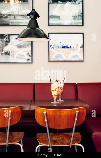 Glasses of ice creams served on restaurant table - Stock Image