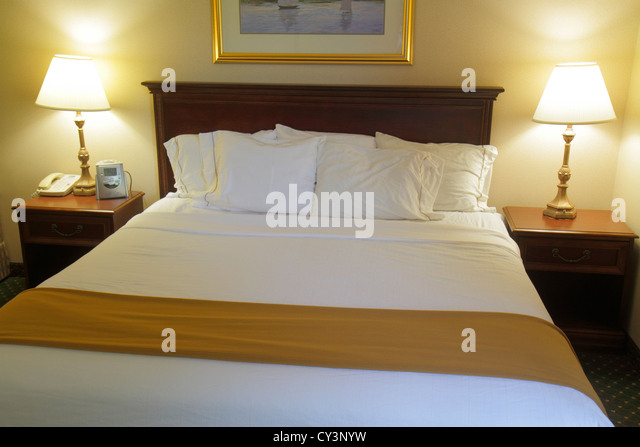 Rhode Island Newport Middletown Holiday Inn Express motel hotel guest room king-size bed made lamps tables - Stock Image
