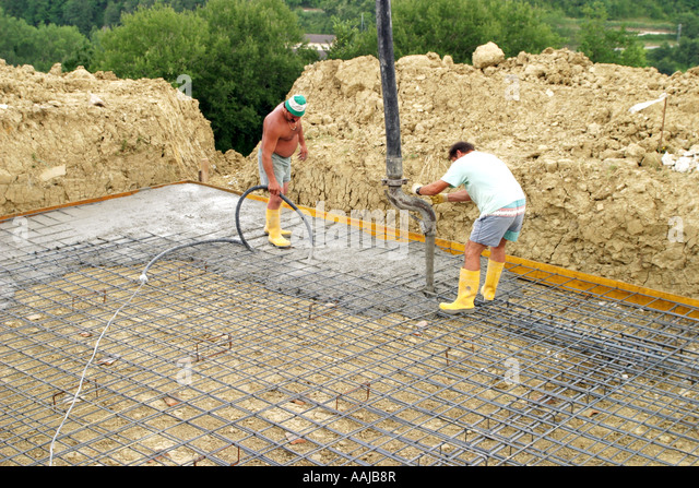 Laying a reinforced steel cage foundation for a swimming pool ,Le Marche ,Italy - Stock Image