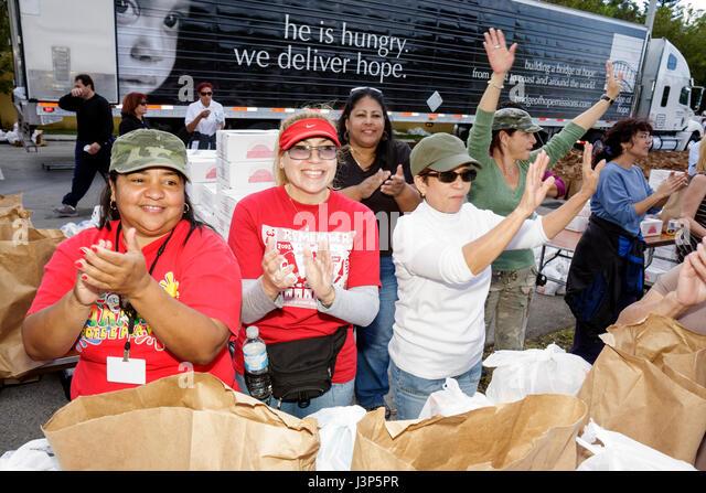 Miami Florida Alpha-Omega Church Thanksgiving turkey give-away give away free food needy volunteers Hispanic woman - Stock Image