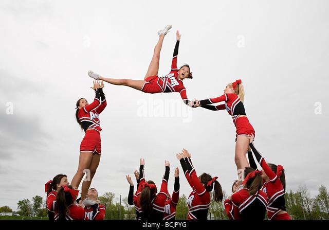 Cheerleaders performing routine - Stock Image
