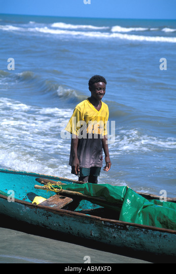 Honduras Garifuna fisherman canoe with sail Sambo Creek Village Caribbean coast - Stock Image