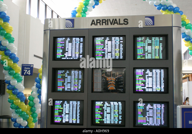 New Jersey Newark Liberty Airport flight arrival information monitors schedules - Stock Image