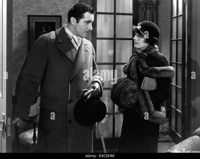 John Boles, Doris Lloyd, on-set of the Film, 'Back Street', 1932 - Stock Image