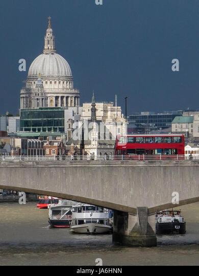 Dark, gloomy skies over the City of London - Stock Image