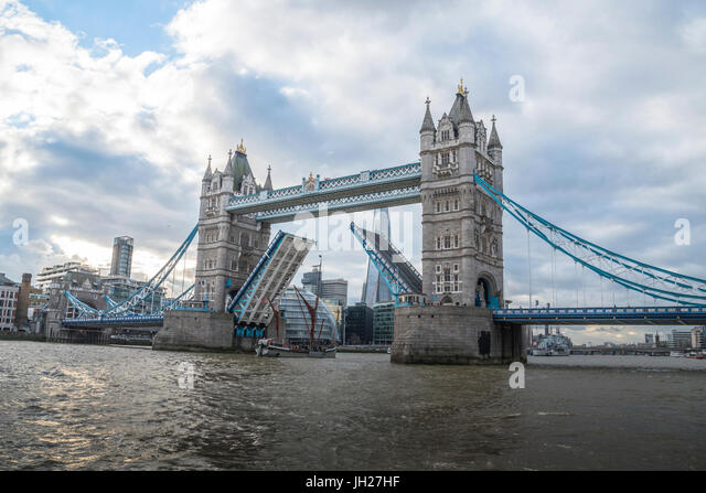 Tower Bridge raised with tall ship passing through with London's City Hall and the Shard in the background, - Stock Image