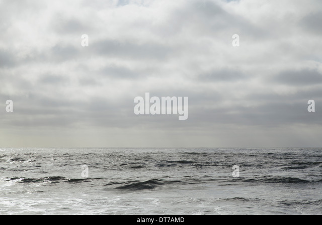 View from the beach over the water to the horizon and the seascape at dusk Olympic National Park Rialto Beach Washington - Stock Image