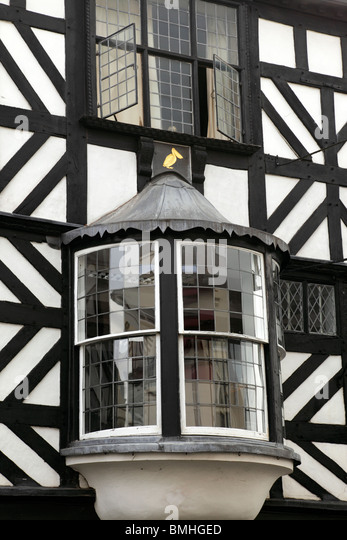 Detail of bay windows on a black & white wattle & daub half timbered building on Broad Street Ludlow Shropshire - Stock Image