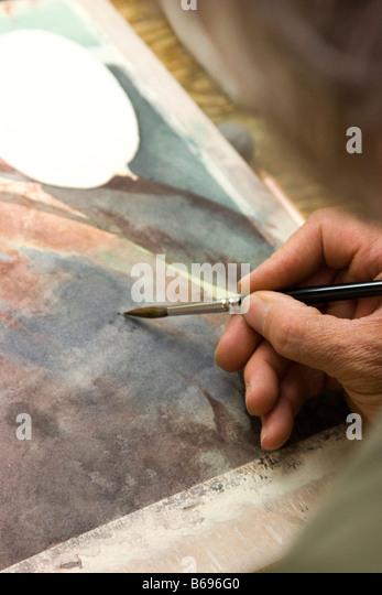 Watercolor artist at work - Stock-Bilder