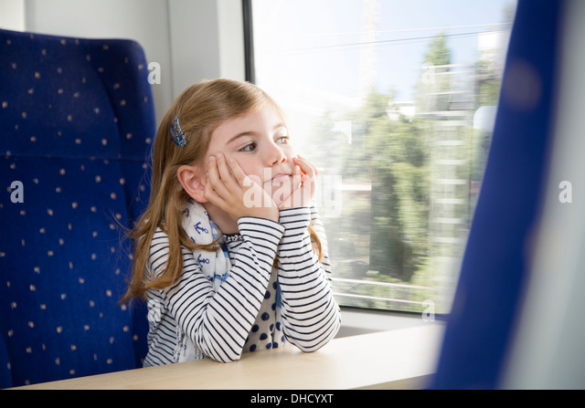 Girl in a train - Stock Image