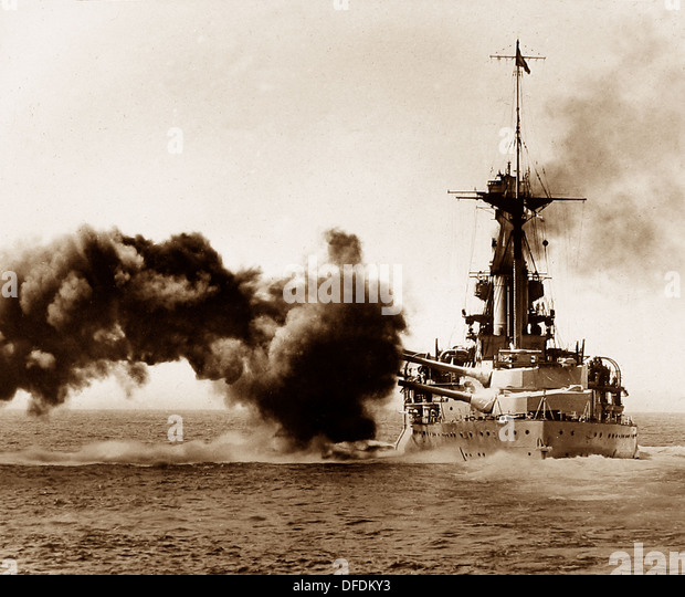 British battleship firing a broadside during WW1 - Stock Image