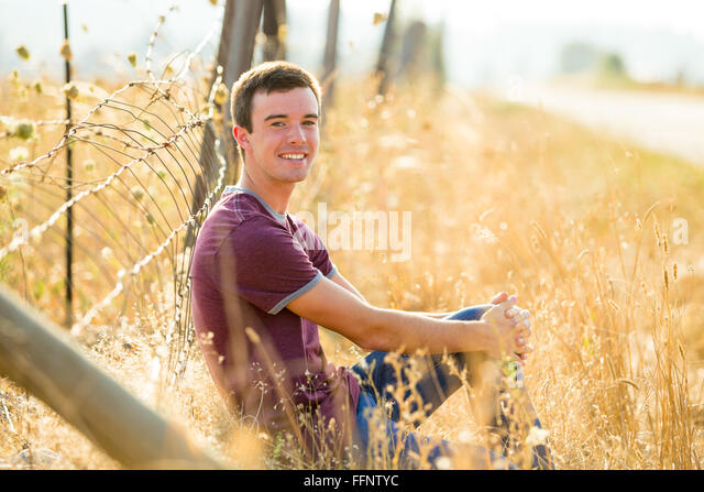 Portrait of a young man who is a high school senior in Oregon. - Stock Image
