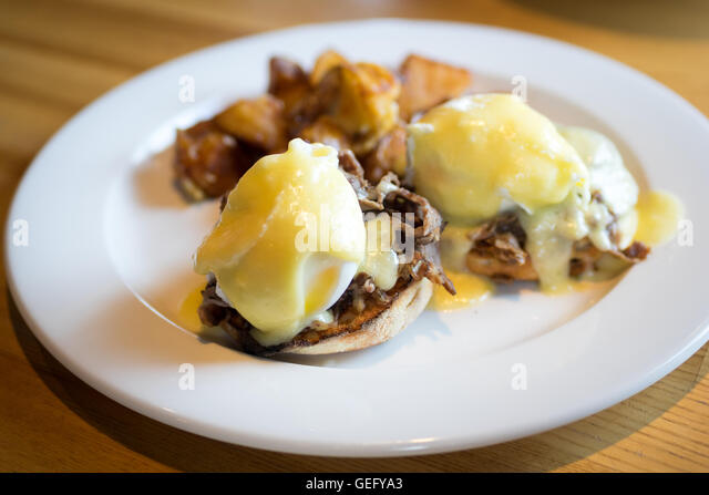 Prime rib eggs benedict with potatoes for breakfast. - Stock Image