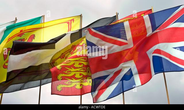 Many flags flying in wind - Stock-Bilder