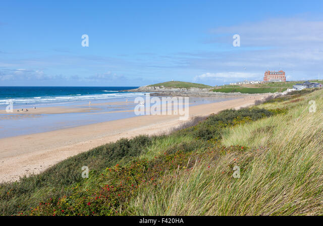 Wide view of Fistral Beach in Newquay, Cornwall viewed from the grassy dunes on a clear, sunny day. - Stock Image