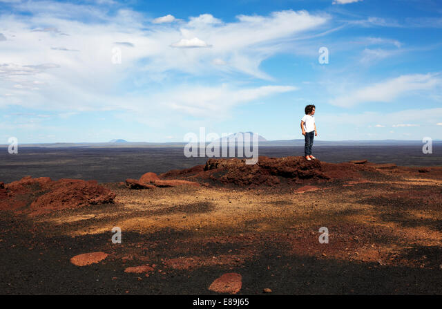 Boy Standing on rocks at Craters of The Moon - Stock-Bilder