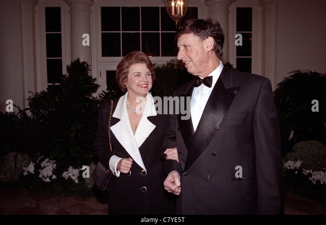 Senator Dianne Feinstein with husband investment banker Richard Blum arrive for the State Dinner at the White House. - Stock Image
