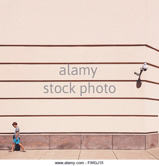Boy walking alone - Stock Image