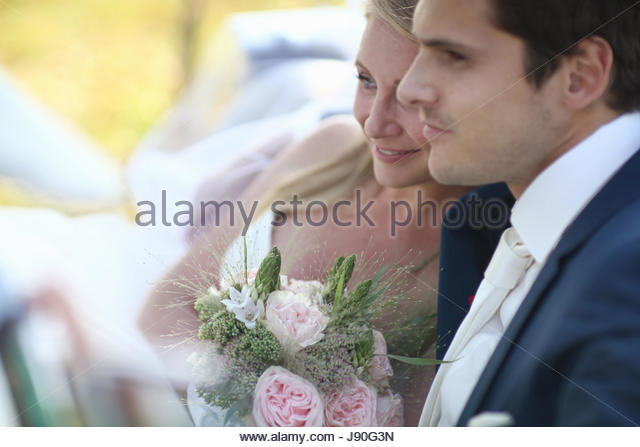 Bride And Groom In Open Top Classic Car On Wedding Day - Stock-Bilder