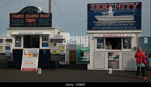Tickets being sold from Serenity sheds at Seahouses, for Farne Island trips, NE England, UK - Stock Image