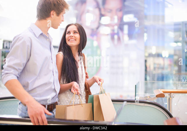 Young couple shopping in mall - Stock Image