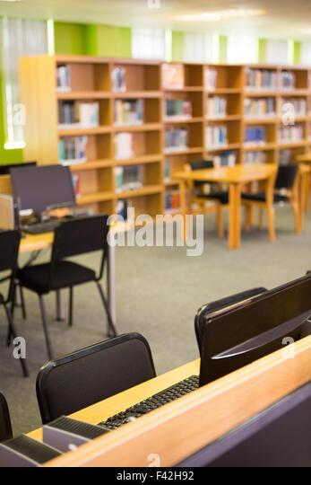 Empty seats and bookshelves - Stock Image