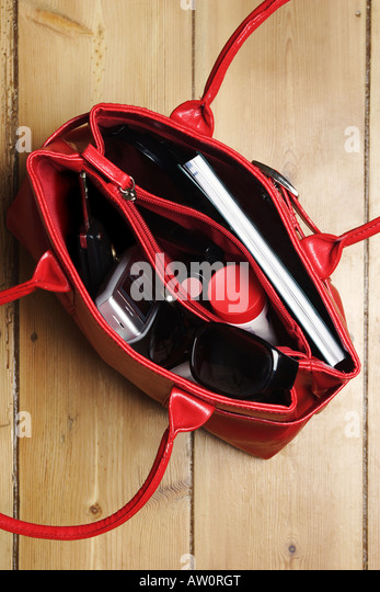 woman's handbag open shot from above - Stock Image