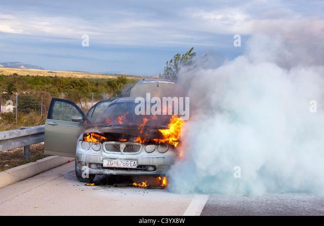 Croatia, Europe, accident, casualty, car, automobile, burn, smoke, street - Stock Image
