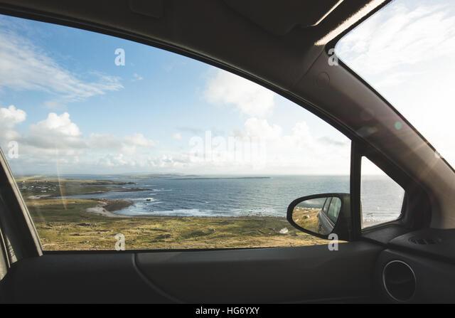 Car window view of the Bun na Leaca coast, County Donegal.  Ireland - Stock-Bilder