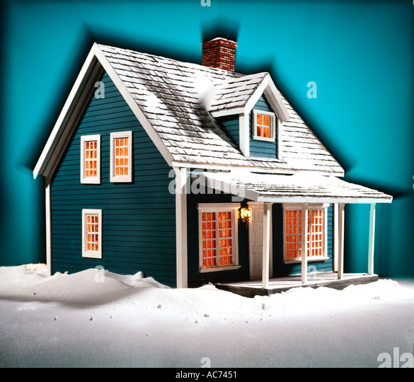 model house in snow - Stock Image