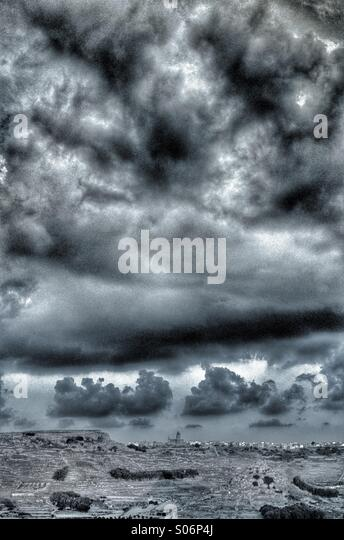 Early morning autumn storm clouds gathering over a Mediterranean island - Stock Image