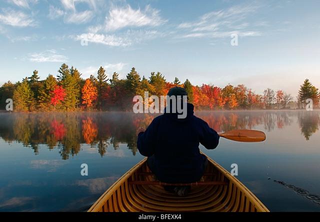 Man, Autumn, Canoe, Kahshe Lake, Muskoka, Ontario - Stock Image