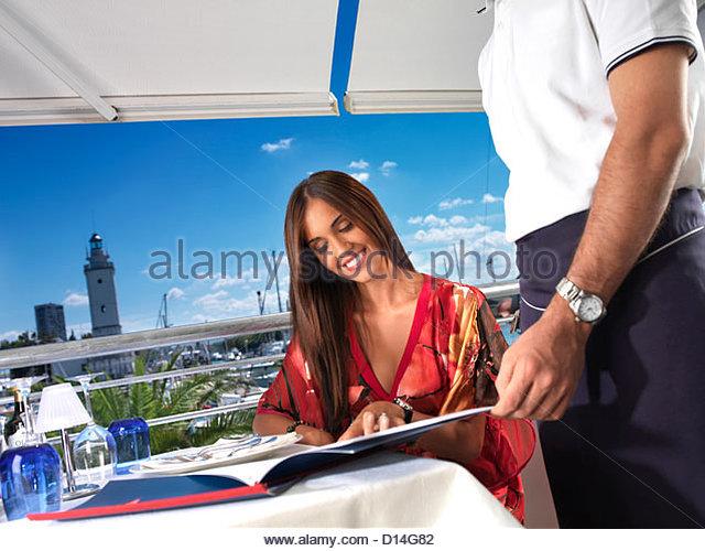 Woman restaurant drinking white wine - Stock Image