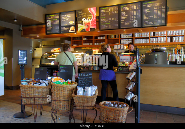 Maine Freeport Main Street Route 1 Starbucks Coffee retail display for sale counter menu customer - Stock Image