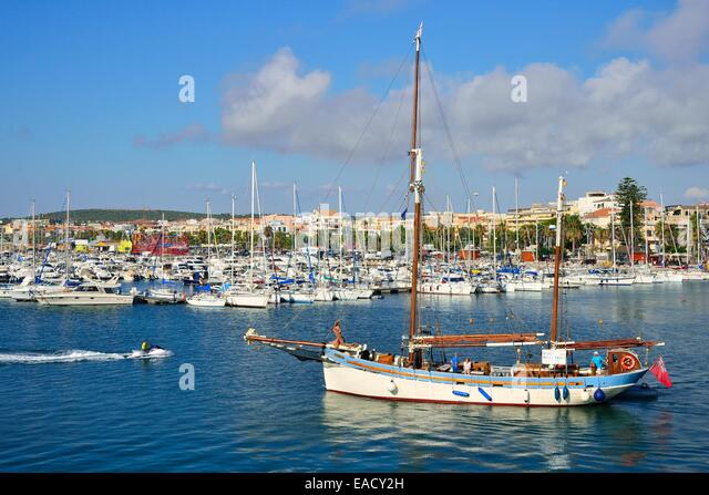 Old sailing boat as excursion boat in the harbour, Alghero, Province of Sassari, Sardinia, Italy - Stock Image