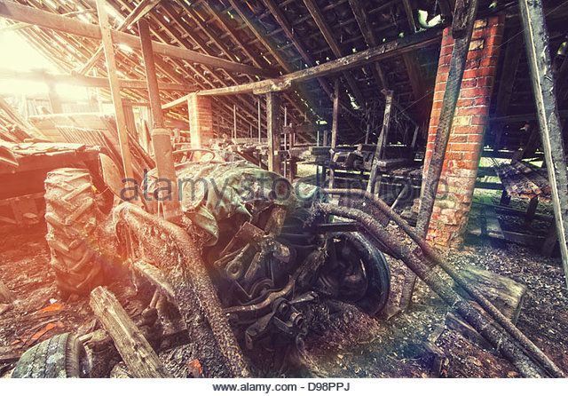 abandoned tractor in sunlight - Stock Image