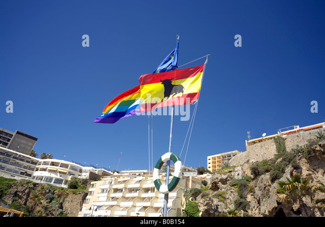 Spanish and EU flags flying on the beach at Torremolinos, Costa del Sol, Spain - Stock Image