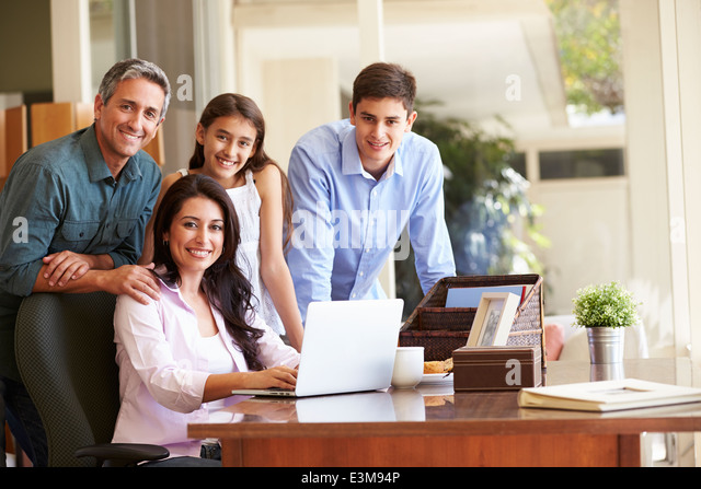 Portrait Of Family Using Laptop Together - Stock Image
