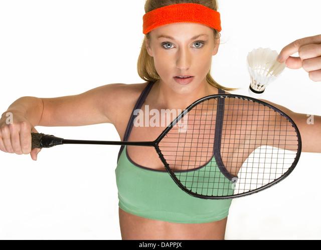 Studio portrait of female badminton player - Stock Image