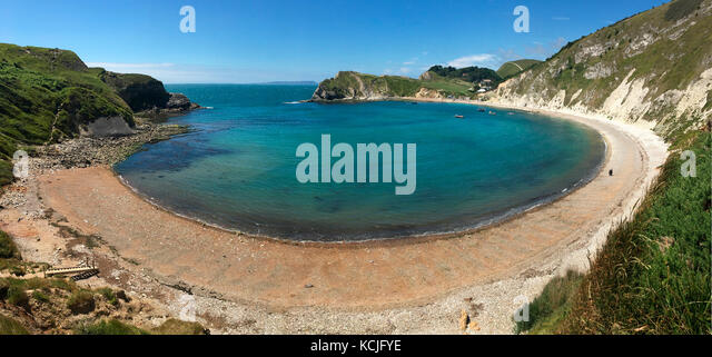 Lulworth Cove near West Lulworth, a village in the Purbeck district of Dorset on the south coast of England. The - Stock Image